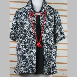 Layered slightly textured floral blouse buttoned